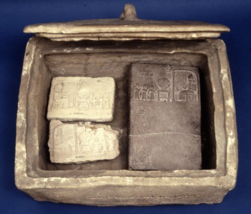 Museum number 91000 Group of Objects Pottery box and the limestone sun-god tablet and its covers deposited in it by Nabopolassar.