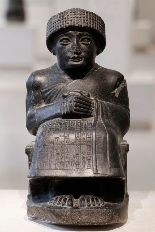 Seated diorite statue of Gudea, prince of Lagash, dedicated to the god Ningishzida, neo-Sumerian period. Marie-Lan Nguyen (2011) https://en.wikipedia.org/wiki/Statues_of_Gudea#/media/File:Gudea_of_Lagash_Girsu.jpg