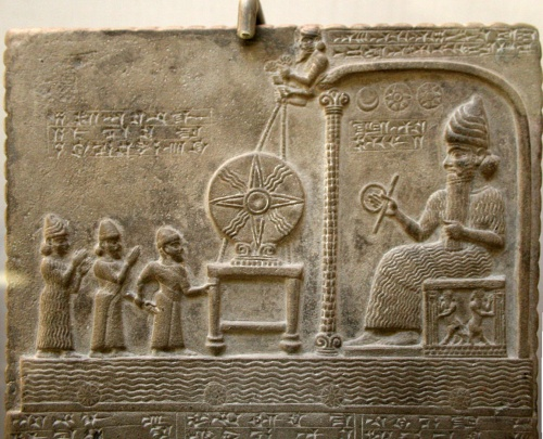 Relief image on the Tablet of Shamash, British Library room 55. Found in Sippar (Tell Abu Habbah), in Ancient Babylonia; it dates from the 9th century BC and shows the sun god Shamash on the throne, in front of the Babylonian king Nabu-apla-iddina (888-855 BC) between two interceding deities. The text tells how the king made a new cultic statue for the god and gave privileges to his temple. https://en.wikipedia.org/wiki/Tablet_of_Shamash#/media/File:Tablet_of_Shamash_relief.jpg