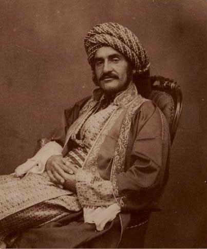 Mr. Hormuzd Rassam, in Mosul, 1854.  http://en.wikipedia.org/wiki/Hormuzd_Rassam#/media/File:Hormuzd.Rassam.reclined.jpg
