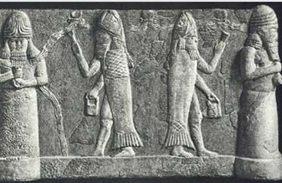 The god Ea is portrayed at far left, with water coursing from his shoulders.  Two fish-apkallu hold banduddu buckets. This bas relief is atypical in that the left-side fish-apkallu holds his banduddu in his right hand, rather than the left, as is portrayed in most other depictions.  This bas relief is also unusual in that it portrays the fish-apkallu with different objects in their raised hands. The raised hand of the fish-apkallu on the left is indistinct, partially covered by the water flowing from the shoulders of the god Ea, while the other fish-apkallu raises an object that I have not yet identified.