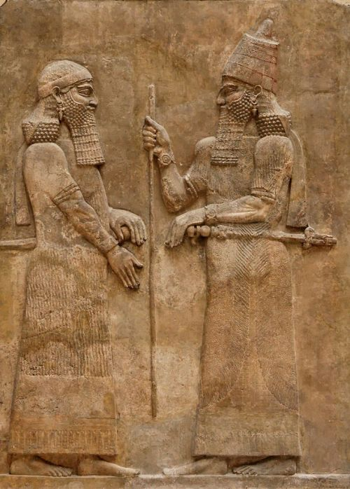 Sargon II and dignitary, said to be his marshal Tartan. Low-relief from the L wall of the palace of Sargon II at Dur Sharrukin in Assyria (now Khorsabad in Iraq), c. 716–713 BC. Fouilles de Paul-Émile Botta en 1843–1844. DimensionsH. 3.30 m (10 ft. 9 ¾ in.), W. 2.30 m (7 ft. 6 ½ in.), D. 33 cm (12 ¾ in.) Current location	 (Inventory) Louvre Museum  Department of Oriental Antiquities, Richelieu wing, ground floor, room 4 Accession number	AO 19873 & AO 19874 Credit line	Excavations of Paul-Émile Botta, 1843–1844 Source/Photographer	Jastrow (2006) http://commons.wikimedia.org/wiki/File:Sargon_II_and_dignitary.jpg