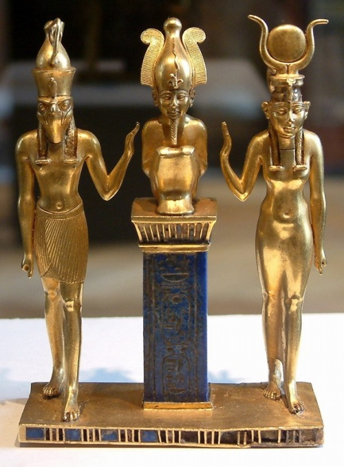 Osiris on a lapis lazuli pillar in the middle, flanked by Horus on the left and Isis on the right (22nd dynasty, Louvre, Paris). Public Domain Uploaded by Borislav Created: between 874 and 850 BC (Twenty-second dynasty) Guillaume Blanchard, Own work, July 2004,  Osiris, Isis and Horus: pendant bearing the name of King Osorkon II http://en.wikipedia.org/wiki/Osiris#/media/File:Egypte_louvre_066.jpg