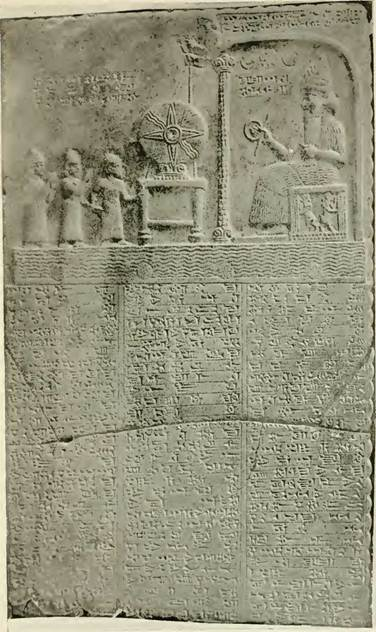 """Limestone tablet depicting king Nabu-aplu-iddina being led into the presence of Šamaš, the sun god; 860 BCE-850 BCE.  Šamaš sits in the E-babbar shrine and holds the rod and ring symbols of kingship (BM 91000). © The British Museum. http://oracc.museum.upenn.edu/amgg/listofdeities/utu/ Alternative interpretation, from Lewis Spence, Myths and Legends of Babylonia and Assyria, London, 1917, p. 292.  """"A god called Uz has for his name the Akkadian word for goat. Mr Hormuzd Rassam found a sculptured stone tablet in a temple of the sun-god at Sippara on which was an inscription to Sin, Shamash, and Ishtar, as being """"set as companions at the approach to the deep in sight of the god Uz.""""  This god Uz is depicted as sitting on a throne watching the revolution of the solar disc, which is placed upon a table and made to revolve by means of a rope or string. He is clad in a robe of goat-skin."""" http://www.wisdomlib.org/mesopotamian/book/myths-and-legends-of-babylonia-and-assyria/d/doc7171.html"""