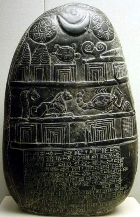 A boundary stone. The eight-pointed star of Ishtar appears at top left, the crescent moon of the Moon God Sin is at top center, and the symbol of the Sun God Shamas appears at top right.