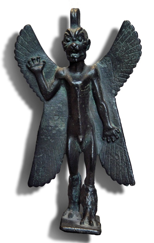 "Pazuzu: a demon-god of the underworld, sometimes invoked for beneficial ends. The inscription covering the back of his wings states: ""I am Pazuzu, son of Hanpa, king of the evil spirits of the air which issue violently from mountains, causing much havoc."" <br />  Pazuzu was particularly associated with the west wind which brought the plague. Under certain circumstances Pazuzu was a protective spirit, particularly to drive his wife Lamashtu back to the underworld. Lamashtu was a demoness who infected men with various diseases.<br />  Pazuzu first appeared in the 1st millennium BC with the body of a man and the head of a scowling dragon-snake, with two pairs of wings and talons of a bird of prey. He has a scorpion's tail and his body is covered in scales.<br />  http://wayback.archive.org/web/20090628125910/<br />  http://www.louvre.fr/llv/oeuvres/detail_notice.jsp?CONTENT%3C%3Ecnt_id=10134198673225951&amp;CURRENT_LLV_NOTICE%3C%3Ecnt_id=10134198673225951&amp;FOLDER%3C%3Efolder_id=9852723696500800&amp;baseIndex=56&amp;bmLocale=en<br />  Bronze statuette of Pazuzu, circa 800 BC –- circa 700 BC, Louvre Museum."