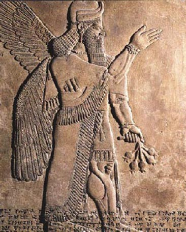 An ummânū, or sage of human descent. The ummânū raises his right hand in the iconic gesture of greeting, with uncertain plants in his left hand.  The rosette design on his wristband is perhaps uniquely not reflected on the opposite wrist. Bracelets appear on the upper arms.  The horned tiara headdress, indicative of divinity, is often worn by such figures.