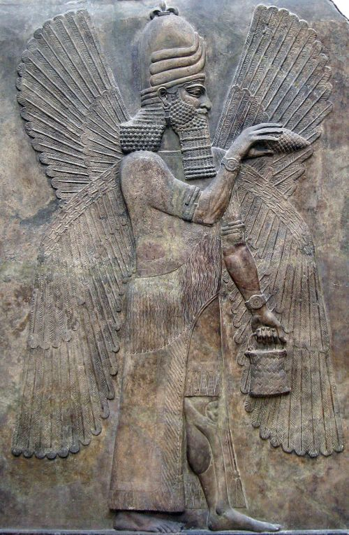 "Human apkallu, known as ummânū, distinguished with two pairs of wings. In a gesture of ritual purification, he holds a ""cleaner"" cone in one hand, and a bucket in the other. The cone is called a mullilu, the bucket a banduddu. From Nimrud, capital of king Ashurnarzipal.<br /> AO 19845"