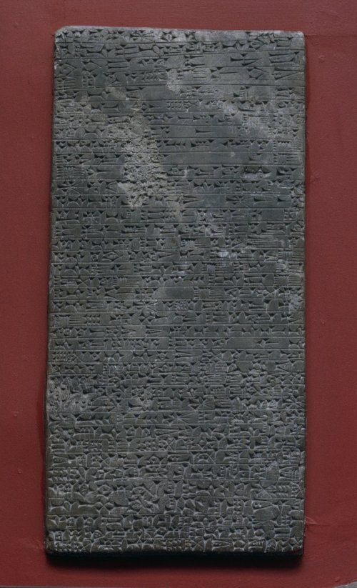 A gypsum memorial slab from the Middle Assyrian Period (1300 - 1275 BCE), findspot Kalah Shergat, Aššur.  The inscription records the name, titles and conquests of King Adad-Nirari, his father Arik-den-ili, his grandfather Enlil-nirari, and his great-grandfather Ashur-uballit I.  Memorializing the restoration of the Temple of Aššur in the city of Aššur, the text invokes curses upon the head of any king or other person who alters or defaces the monument.  The artifact was purchased from the French Consul in Mosul in 1874 for £70, the British Museum notes reference Mr. George Smith and The Daily Telegraph with an acquisition date of 1874.  Bezold, Carl, Catalogue of the Cuneiform Tablets in the Kouyunjik Collection of the British Museum, IV, London, BMP, 1896. Furlani, G, Il Sacrificio Nella Religione dei Semiti di Babilonia e Assiria, Rome, 1932. Rawlinson, Henry C; Smith, George, The Cuneiform Inscriptions of Western Asia, IV, London, 1861. Budge, E A W, A Guide to the Babylonian and Assyrian Antiquities., London, 1922. Budge, E A W, The Rise and Progress of Assyriology, London, Martin Hopkinson & Co, 1925. Gray