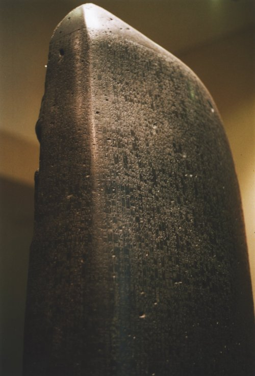 The Code of Hammurabi was discovered by archaeologists in 1901, with its editio princeps translation published in 1902 by Jean-Vincent Scheil. This nearly complete example of the Code is carved into a diorite stele in the shape of a huge index finger, 2.25-metre (7.4 ft) tall. The Code is inscribed in Akkadian, using cuneiform script. It is currently on display in the Louvre, with exact replicas in the Oriental Institute at the University of Chicago, the library of the Theological University of the Reformed Churches (Dutch: Theologische Universiteit Kampen voor de Gereformeerde Kerken) in The Netherlands, the Pergamon Museum of Berlin and the National Museum of Iran in Tehran. CC BY-SA 2.0 fr File:Code-de-Hammurabi-1.jpg Uploaded by Rama Uploaded: 8 November 2005