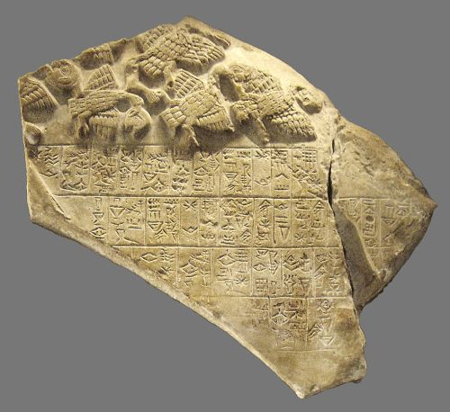 A fragment of the victory stele of king Eannutum of Lagash over Umma, called «Stele of Vultures». Circa 2450 BC, Sumerian archaic dynasties. Found in 1881 in Girsu (now Tello, Iraq), Mesopotamia, by Édouard de Sarzec.