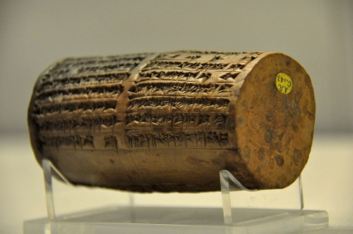 The cuneiform on this clay cylinder mentions the renovations of the Temple of the Moon god Sin undertaken at Ur by King Nabonidus.<br />  It includes a prayer for the king and for his son, Belshazzar.<br />  From Ur, southern Mesopotamia, Neo-Babylonian Period, 555 BCE - 539 BCE.<br />  Held at the British Museum, London.<br />  Photo by Osama Shukir Muhammed Amin, released into the public domain by the author. <br /> https://en.wikipedia.org/wiki/Cylinders_of_Nabonidus#/media/File:Cylinder_of_Nabonidus_from_the_temple_of_Shamash_at_Larsa,_Mesopotamia..JPG