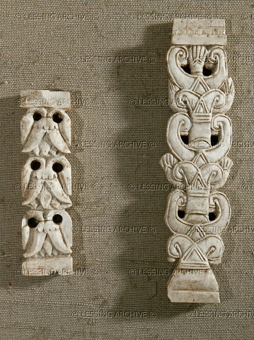 "Three superposed lotus flowers forming a ""Sacred tree."" Ivory (open-work, fragment)<br /> Right: Lotus flower with 5 petals.<br /> 11.3 x 3 cm, Louvre AO 11481;<br /> Left: Ivory plaque with top and bottom border from Arslan Tash, ancient Hadatu, Northern Syria.<br /> 7.6 x 2.1 cm, Louvre AO 11482.<br /> I believe that the sacred tree fragment on the left is upside down. The blossoms should be oriented upwards."