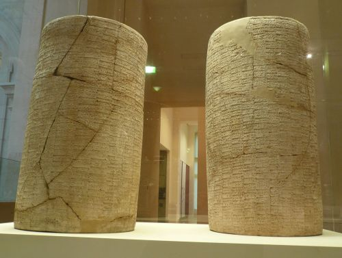 "Cylinders of the Sumerian ruler Gudea with cuneiform texts, now in the Louvre.  Dated to 2125 BCE, they recount the Building of Ningursu's temple in Sumerian. The cylinders were made by Gudea, ruler of Lagash, and excavated in 1877 during digs by Ernest de Sarzec beneath the Eninnu temple complex at Telloh (ancient Girsu).  The complete name of the temple complex was ""E-Ninnu-Imdugud-babbara,"" meaning ""House Ninnu, the Flashing Thunderbird,"" a reference to a thunderbird in the second dream that compelled Gudea to build the temple.  They are now in the permanent collection of the Louvre Museum. They are the largest cuneiform cylinders to-date, and they contain the longest known text written in the Sumerian language.  Labelled cylinders A and B, the cuneiform was intended to be read with the cylinders in a horizontal position with a perforation in the middle for mounting.  The text has been translated by Jeremy Black, G. Cunningham, E. Robson and G. Zólyomi, available from The Electronic Text Corpus of Sumerian Literature, Oxford, 1998.  http://etcsl.orinst.ox.ac.uk/section2/tr217.htm Accession numbers MNB 1511 and MNB 1512.  Photo by Ramessos.  I, the copyright holder of this work, release this work into the public domain. This applies worldwide. In some countries this may not be legally possible; if so: I grant anyone the right to use this work for any purpose, without any conditions, unless such conditions are required by law. https://en.wikipedia.org/wiki/Gudea_cylinders"