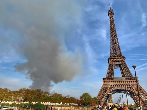 Q the view of the Notre Dame Fire From Michael's Cruise Boat on the Seine April 17 2019 michelle-obama-paris-cruise-alain-ducasse-photos-1